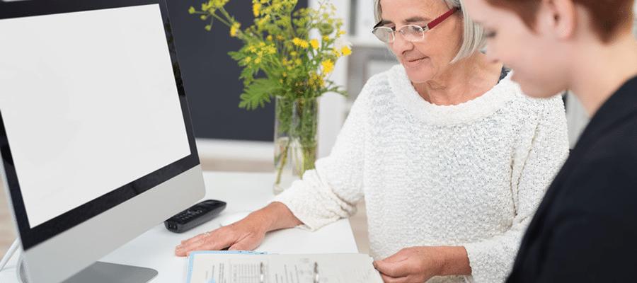 Nonprofit Women Working at Computer - Eleo Online Blog